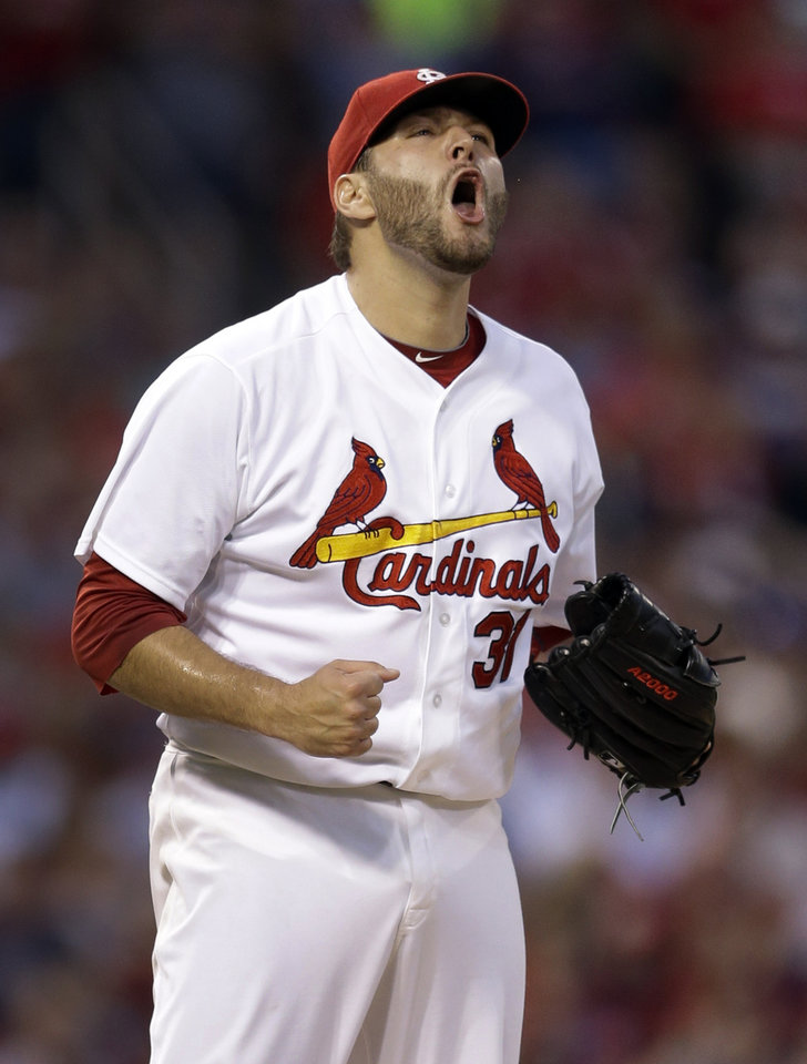 Photo - St. Louis Cardinals starting pitcher Lance Lynn celebrates after striking out Los Angeles Dodgers' Matt Kemp with the bases loaded to end the top of the third inning of a baseball game Friday, July 18, 2014, in St. Louis. (AP Photo/Jeff Roberson)