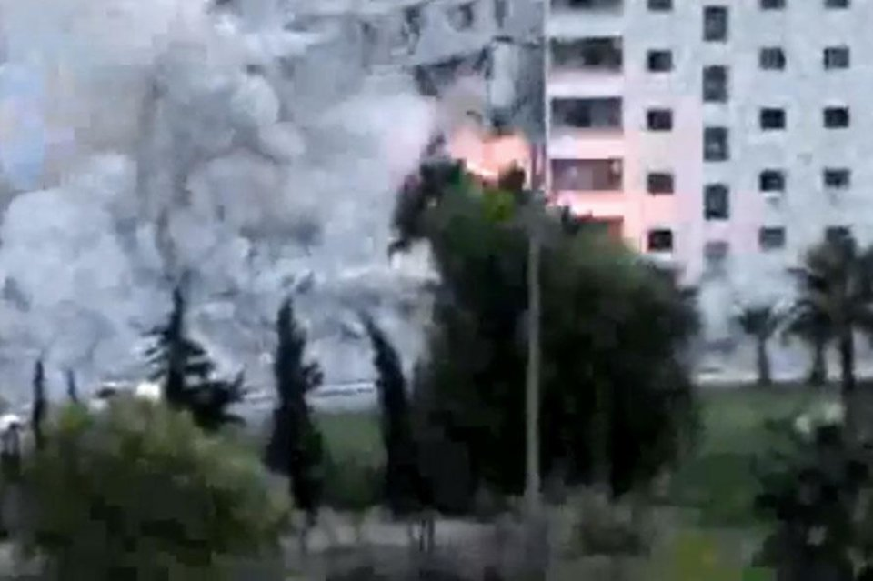 In this image taken from video obtained from the Ugarit News, which has been authenticated based on its contents and other AP reporting on Wednesday, Oct. 10, 2012, smoke rises from a building due to shelling, in Damascus, Syria, on Tuesday, Oct. 9, 2012. (AP Photo/Ugarit News via AP video)