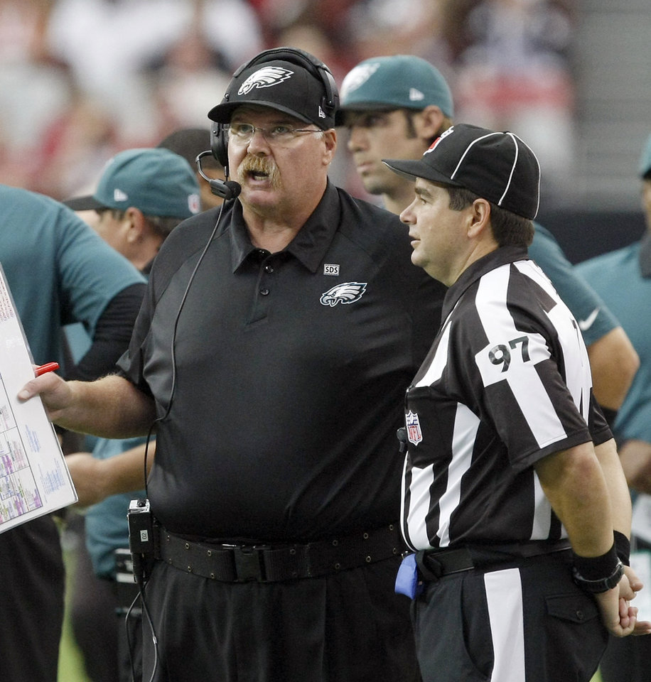 Photo -   Philadelphia Eagles head coach Andy Reid, left, talks to NFL line judge George Shinkan in the fourth quarter during an NFL football game on Sunday, Sept. 23, 2012, in Glendale. (AP Photo/Rick Scuteri)