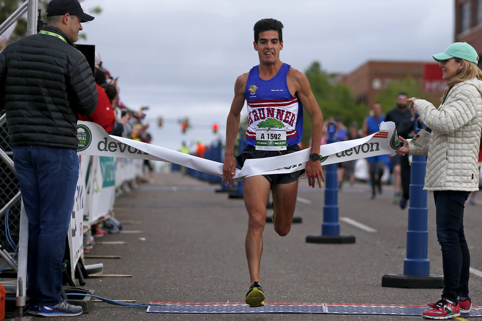 Photo - Arya Bahreini wins the Oklahoma City Memorial Marathon in Oklahoma City, Sunday, April 30, 2017. Photo by Bryan Terry, The Oklahoman