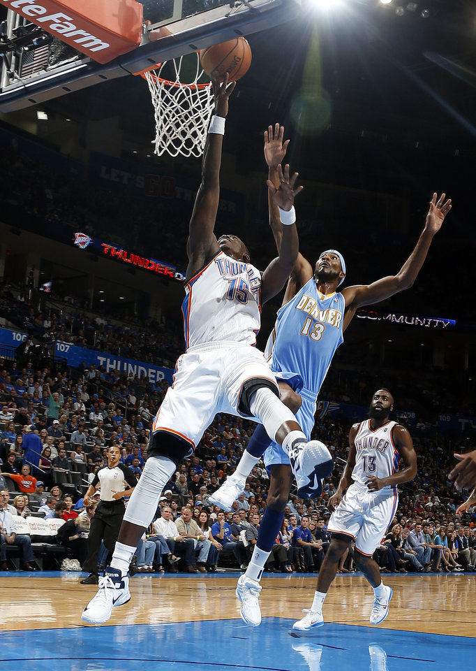 Oklahoma City's Reggie Jackson (15) shoots as Denver's Corey Brewer (13) defends during the NBA preseason basketball game between the Oklahoma City Thunder and the Denver Nuggets at the Chesapeake Energy Arena, Sunday, Oct. 21, 2012. Photo by Sarah Phipps, The Oklahoman