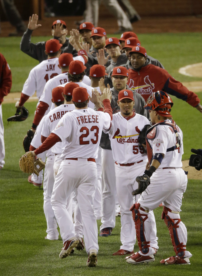 Photo -   The St. Louis Cardinals celebrate after Game 4 of baseball's National League championship series against the San Francisco Giants Thursday, Oct. 18, 2012, in St. Louis. The Cardinals won 8-3 to take a 3-1 lead in the series. (AP Photo/Mark Humphrey)