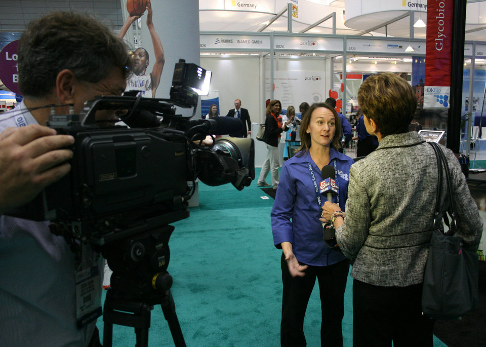 Photo - ABC Massachusetts news crew interviews Jennifer Seaton from the Greater Oklahoma City Chamber at the Oklahoma booth.   unknown