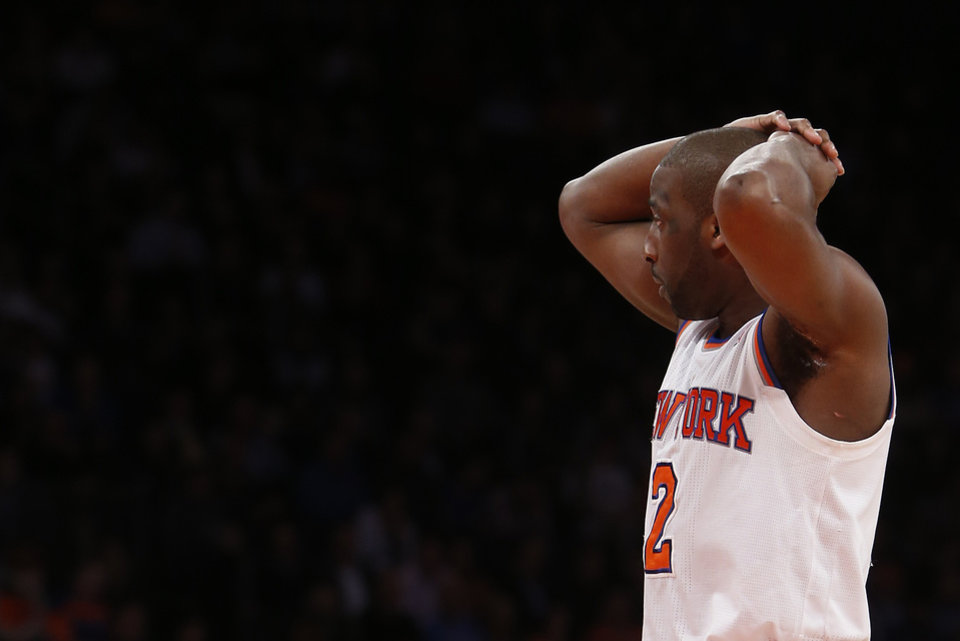 Photo - In this Monday, Feb. 24, 2014, photo, New York Knicks' Raymond Felton reacts during the second half of an NBA basketball game against the Dallas Mavericks in New York. Felton was arrested Tuesday on weapons charges after a lawyer for Felton's wife turned in a loaded gun allegedly belonging to the basketball star, saying she didn't want it in her home, police said. Felton turned himself in at 12:50 a.m. Tuesday, not long after the Knicks lost to the Mavericks.  (AP Photo/Jason DeCrow)