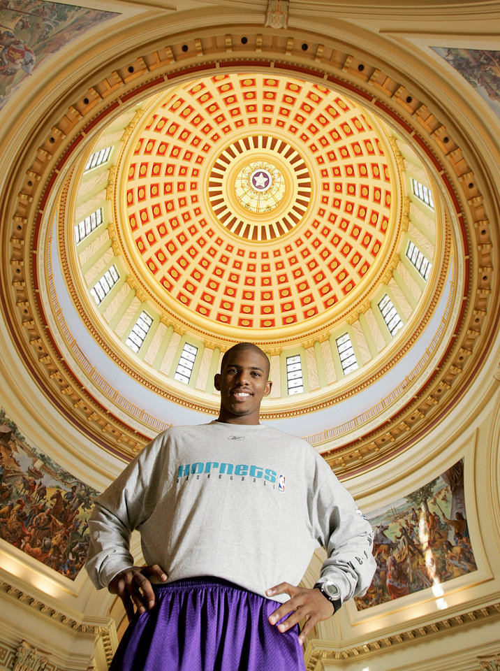Photo - New Orleans/Oklahoma City Hornets NBA basketball player Chris Paul poses for a photo at the Oklahoma state Capitol with the inside of the dome in the background, October 10, 2005, in Oklahoma City. By Nate Billings/The Oklahoman