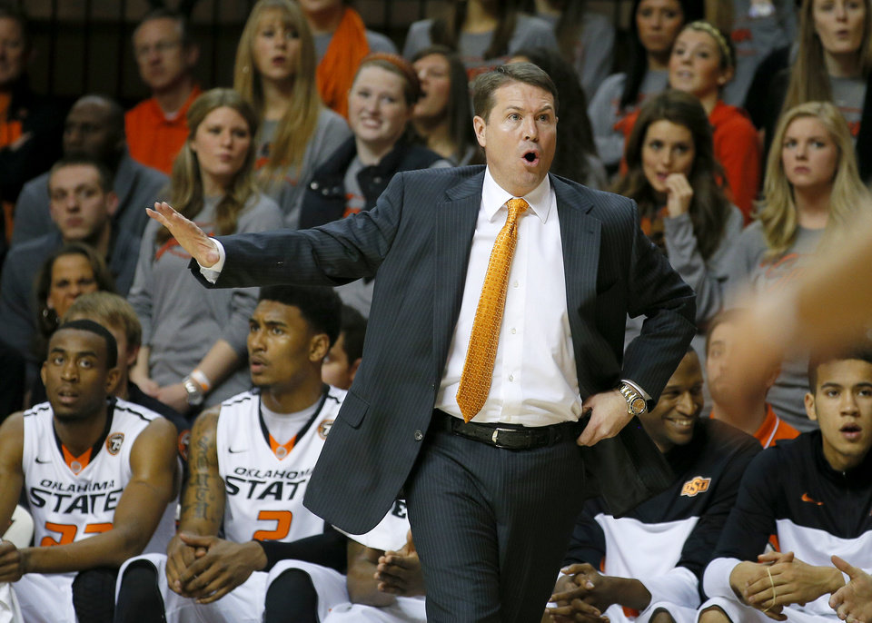 Photo - Oklahoma State coach Travis Ford reacts to a call during an NCAA college basketball game between Oklahoma State University (OSU) and TCU at Gallagher-Iba Arena in Stillwater, Okla., Wednesday, Jan. 15, 2014. Oklahoma State won 82-50. Photo by Bryan Terry, The Oklahoman