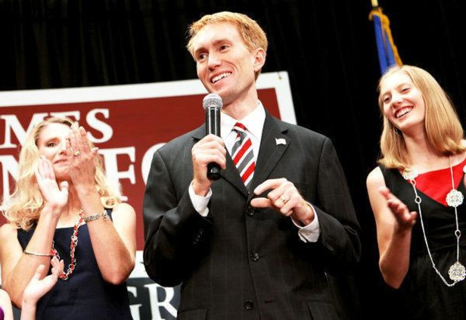 Photo - With his wife Cindy (left) and daughter Hannah applauding behind him, James Lankford speaks to supporters during a watch party at the Oklahoma Sports Hall of Fame in Oklahoma City on Tuesday, August 24, 2010. Photo by John Clanton, The Oklahoman ORG XMIT: KOD