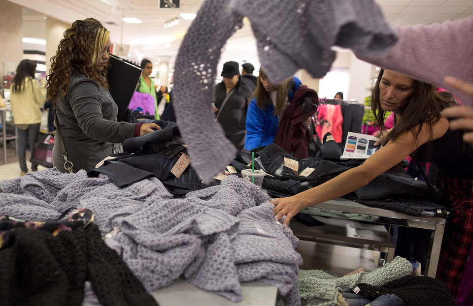 Photo - Shoppers rummage through a pile of sweaters on sale at a J.C. Penney store in Las Vegas. AP PHOTO  Julie Jacobson - AP