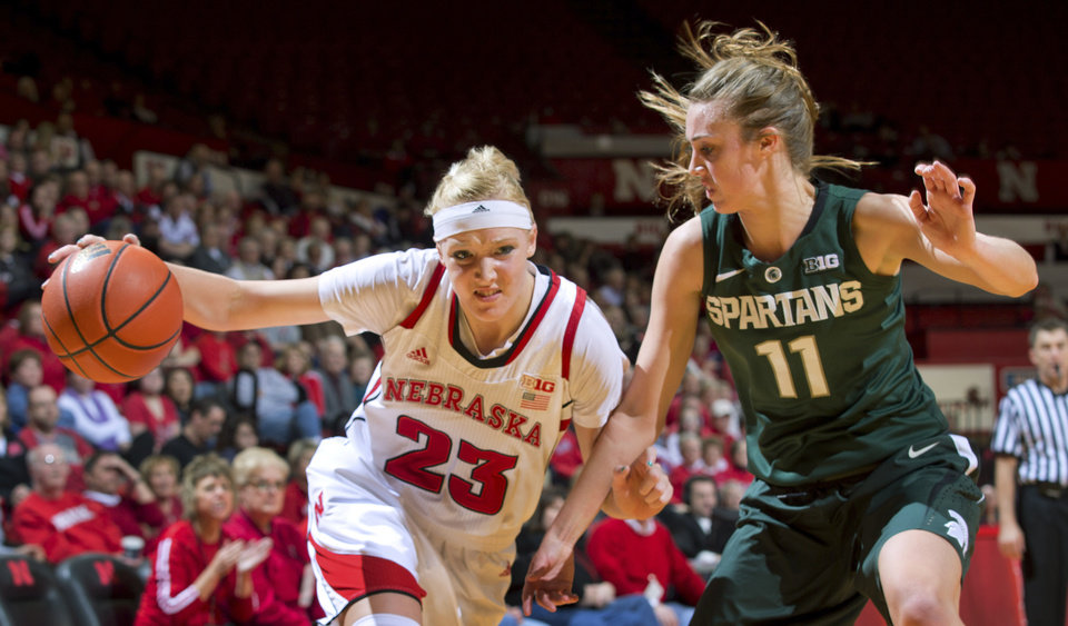 Photo - Nebraska's Emily Cady drives to the basket against Michigan State's Annalise Pickrel during the second half of their NCAA college basketball game, Thursday, Jan. 24, 2013, in Lincoln, Neb. Nebraska won 59-54. (AP Photo/The World-Herald, Mark Davis) MAGS OUT; ALL NEBRASKA LOCAL BROADCAST TV OUT