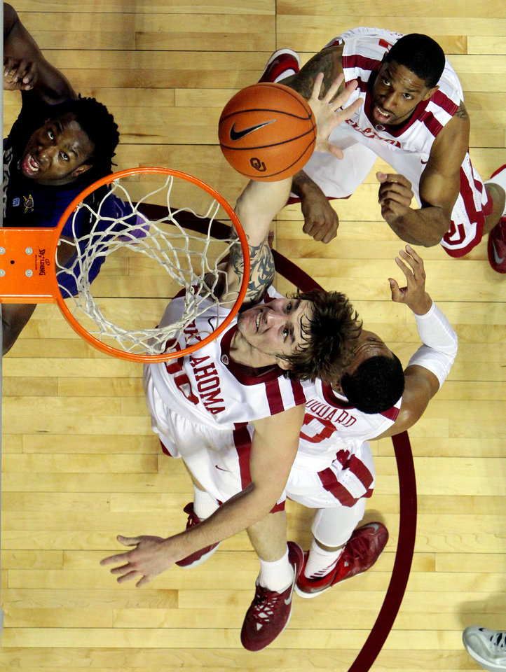 Ryan Spangler goes for a rebound as the University of Oklahoma Sooner (OU) men play the Kansas State Wildcats (KS) in NCAA, college basketball at The Lloyd Noble Center on Saturday, Feb. 22, 2014 in Norman, Okla. Photo by Steve Sisney, The Oklahoman