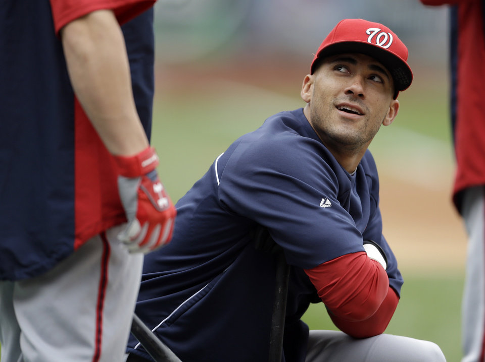 Photo -   Washington Nationals' Ian Desmond, right, looks up as he talks with teammate Bryce Harper during baseball practice, Saturday, Oct. 6, 2012, in St. Louis. The Nationals and the St. Louis Cardinals are scheduled to play Game 1 in the National League division series on Sunday. (AP Photo/Jeff Roberson)