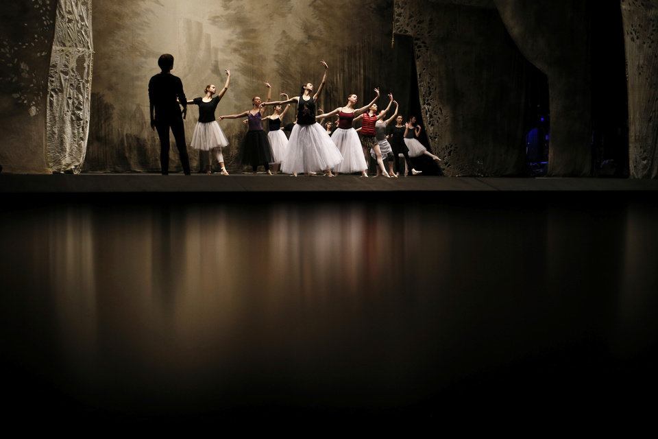 Photo - In this photo made Tuesday, Feb. 5, 2013, Bolshoi dancers hold a rehearsal of the ballet Giselle in the Bolshoi Theater in Moscow, Russia. Pavel Dmitrichenko, a Russian ballet star who most recently played the title role in