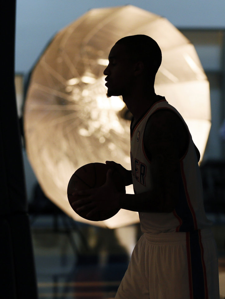 Photo - Eric Maynor is silhouetted as he poses for a photo during media day for the Oklahoma City Thunder NBA basketball team at the Thunder Events Center in Oklahoma City, Monday, Oct. 1, 2012.  Photo by Nate Billings, The Oklahoman