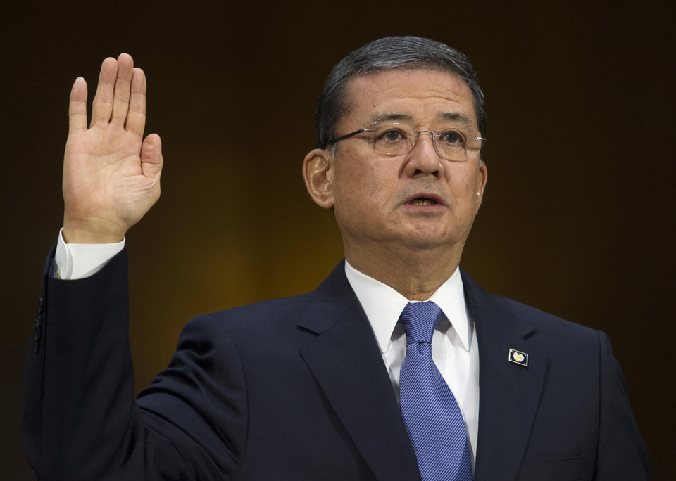 Photo - Veterans Affairs Secretary Eric Shinseki is sworn in on Capitol Hill in Washington, Thursday, May 15, 2014, prior to testify before the Senate Veterans Affairs Committee hearing to examine the state of Veterans Affairs health care. (AP Photo/Cliff Owen)