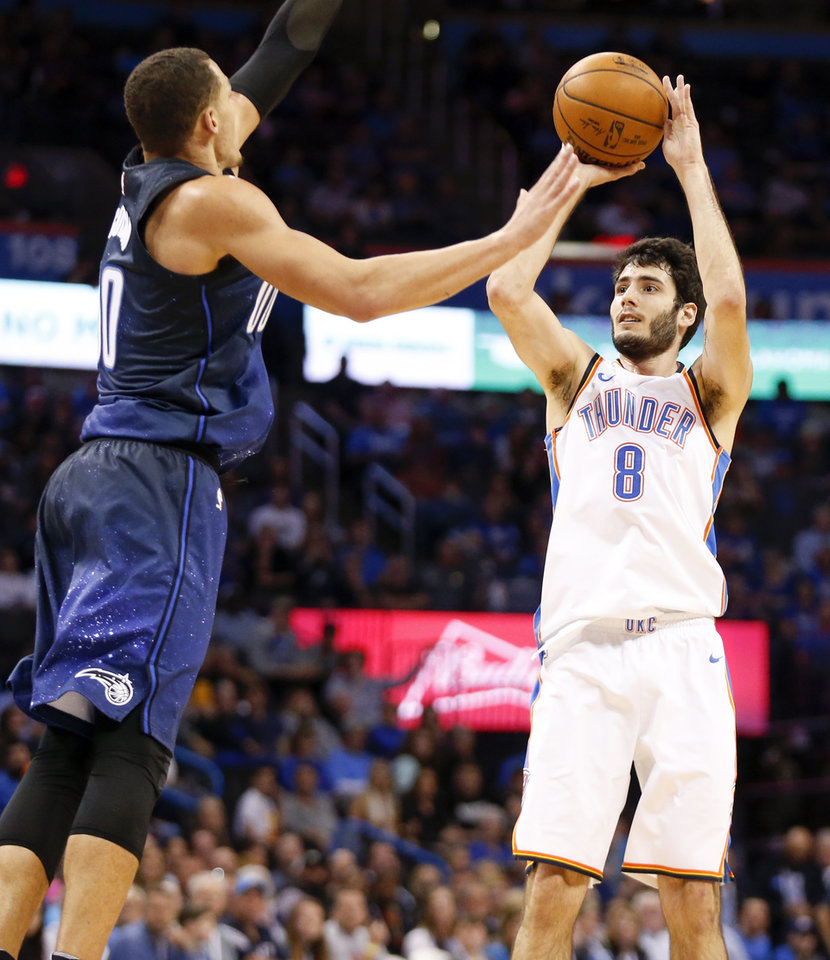 Photo - Oklahoma City's Alex Abrines (8) shoots as Orlando's Aaron Gordon (00) defends during an NBA basketball game between the Oklahoma City Thunder and the Orlando Magic at Chesapeake Energy Arena in Oklahoma City, Monday, Feb. 26, 2018. Photo by Nate Billings, The Oklahoman