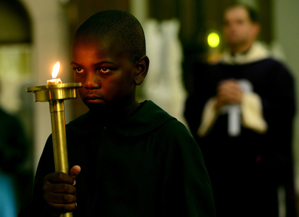 An altar boy participates in a Mass at the Holy Trinity Catholic Church in Braamfontein,  Johannesburg, Sunday March 3, 2013. Catholics around the world attended the first Sunday masses since Benedict XVI stepped down as pope. Many prayed for a energetic, new leader to reinvigorate what many said was an ailing institution (AP Photo)