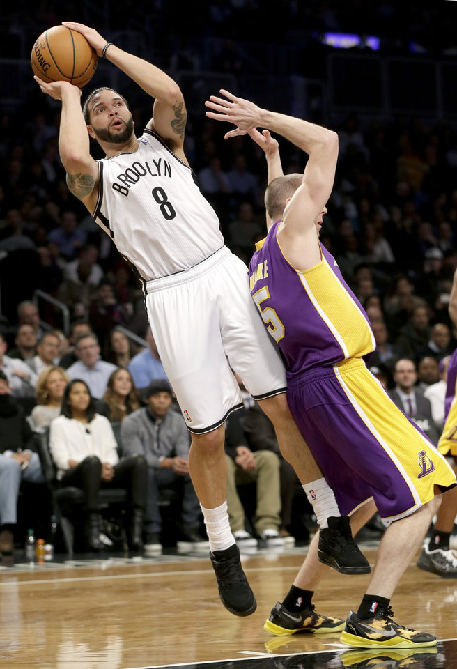 Brooklyn Nets' Deron Williams shoots while Los Angeles Lakers' Steve Blake defends during the first half of the NBA basketball game at the Barclays Center Tuesday, Feb. 5, 2013 in New York. (AP Photo/Seth Wenig)