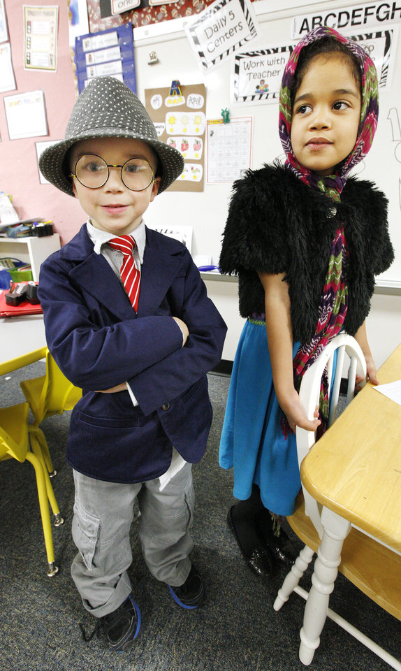 Kindergartners Christian Watson, 6, and Shaelin Kunz, 5, dressed as a 100-year-old man and woman to celebrate the 100th day of school at James L. Dennis Elementary School.
