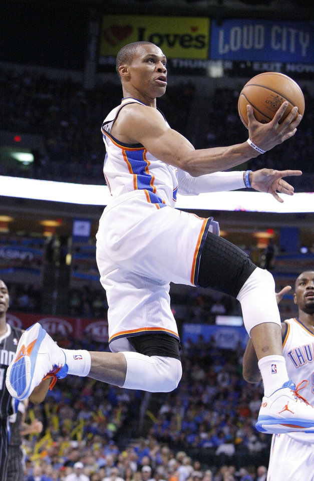 Photo - Oklahoma City Thunder guard Russell Westbrook goes to the basket against the Orlando Magic during the third quarter of an NBA basketball game in Oklahoma City, Friday, March 15, 2013.  Oklahoma City won 117-104.  (AP Photo/Alonzo Adams)