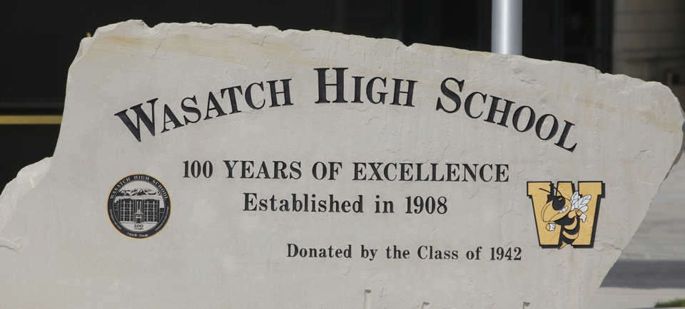Photo - The Wasatch High School sign is shown Thursday, May 29, 2014, in Heber City, in Utah. A group of Utah high school students said they were shocked and upset to discover their school yearbook photos were digitally altered, with sleeves and higher necklines drawn on to cover up bare skin. Several students at Wasatch High School in Heber City say that their outfits did meet the school dress code and they've worn them on campus many times.  (AP Photo/Rick Bowmer)