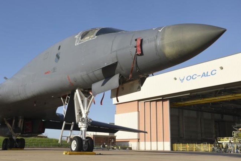 Photo -  A jet parked being overhauled is parked outside a maintenance building at the Tinker Air Force Base Air Logistics Center. Officials said Wednesday they have learned of the first confirmed case of COVID-19 on the base. [GREG L. DAVIS/USAF FILE]