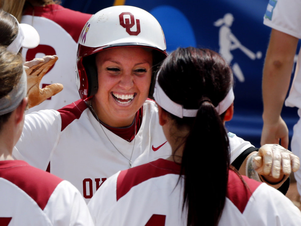 Photo - Oklahoma's Javen Henson, facing, celebrates her home run with another home run hitter, Lauren Chamberlain as the University of Oklahoma Sooner (OU) softball team plays Tennessee in game three of the NCAA super regional at Marita Hynes Field on May 25, 2014 in Norman, Okla. Photo by Steve Sisney, The Oklahoman