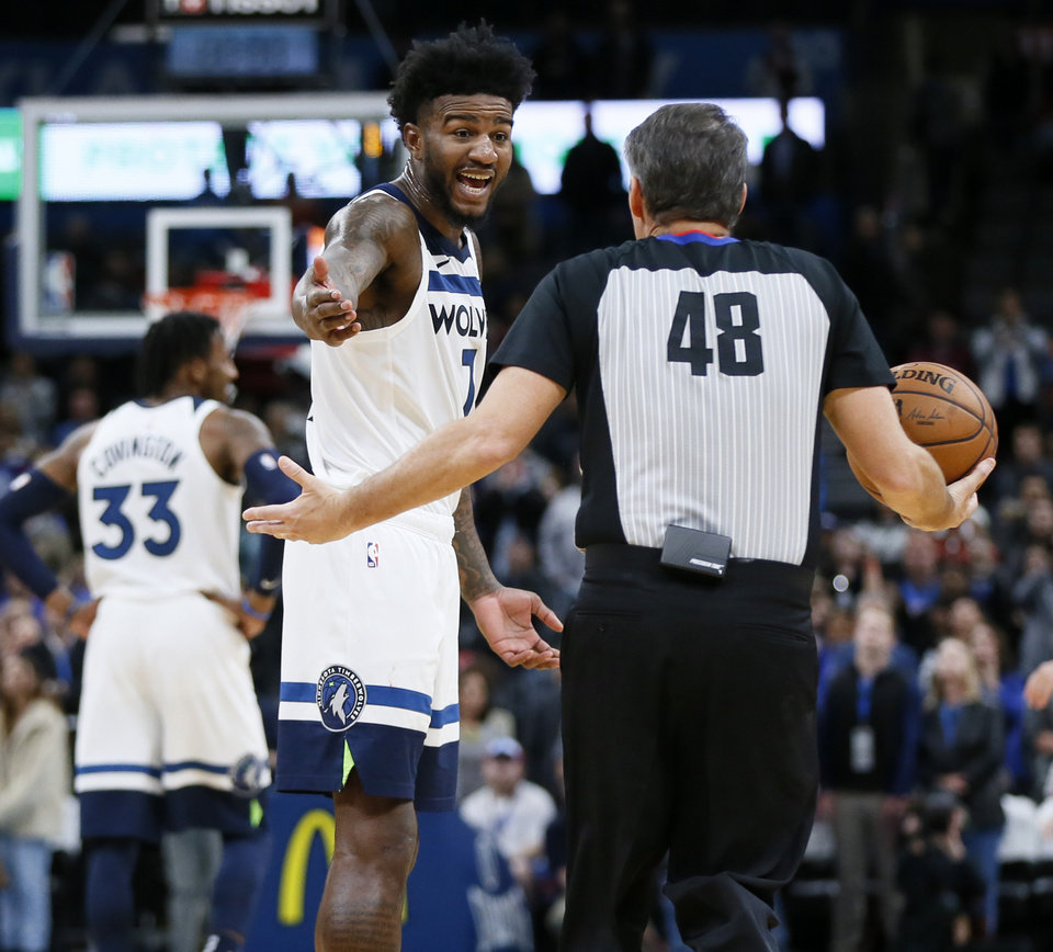 Photo - Minnesota's Jordan Bell (7) talks to official Scott Foster after Bell's untucked jersey caused a delay of game with 1.1 seconds left in the fourth quarter of an NBA basketball game between the Minnesota Timberwolves and the Oklahoma City Thunder at Chesapeake Energy Arena in Oklahoma City, Friday, Dec. 6, 2019. Oklahoma City won 139-127 in overtime. [Nate Billings/The Oklahoman]