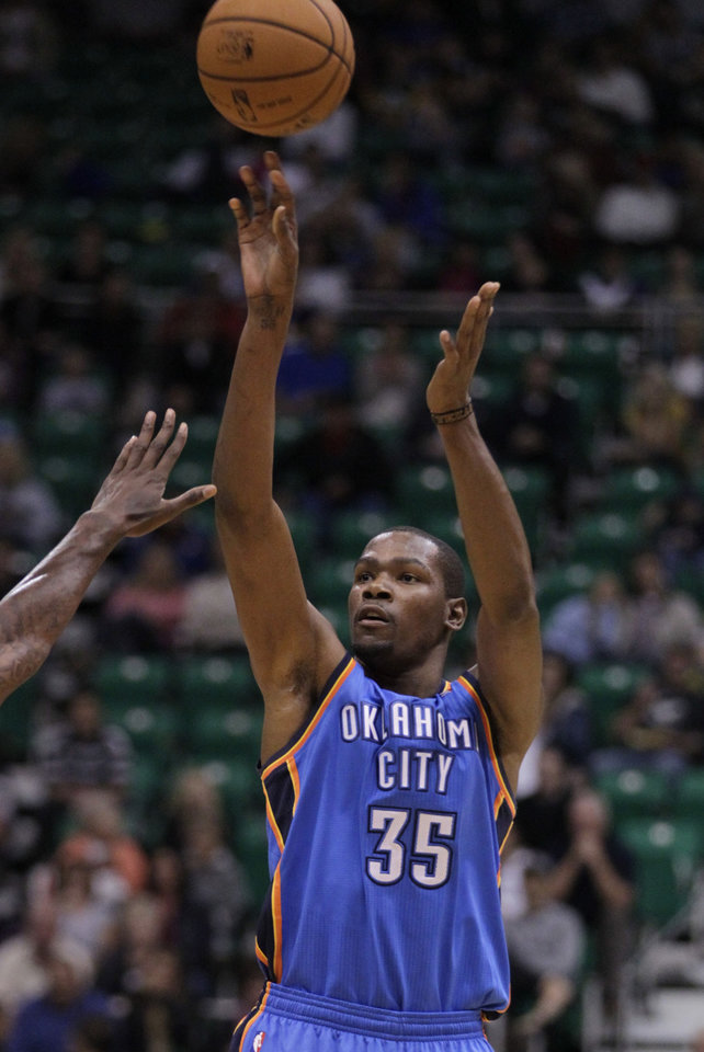 Oklahoma City Thunder forward Kevin Durant (35) shoots in the first quarter during a preseason NBA basketball game against Utah Jazz, Friday, Oct. 12, 2012, in Salt Lake City. (AP Photo/Rick Bowmer) ORG XMIT: UTRB105