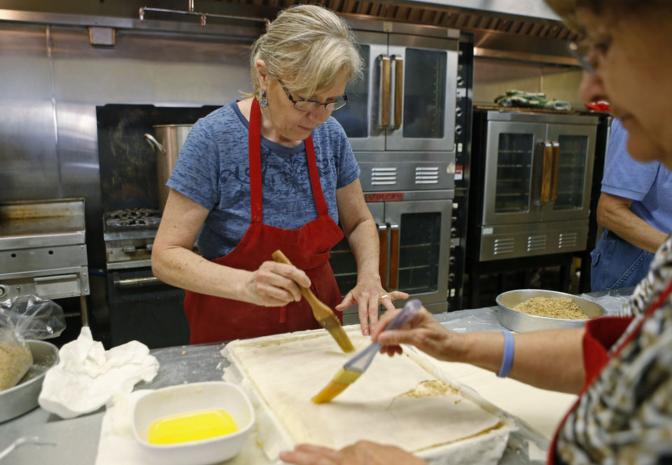 Angela Angelidis works with others making Baklava at St. George's Greek Orthodox Church in Oklahoma City, Saturday, Sept. 1, 2012. Photo by Bryan Terry