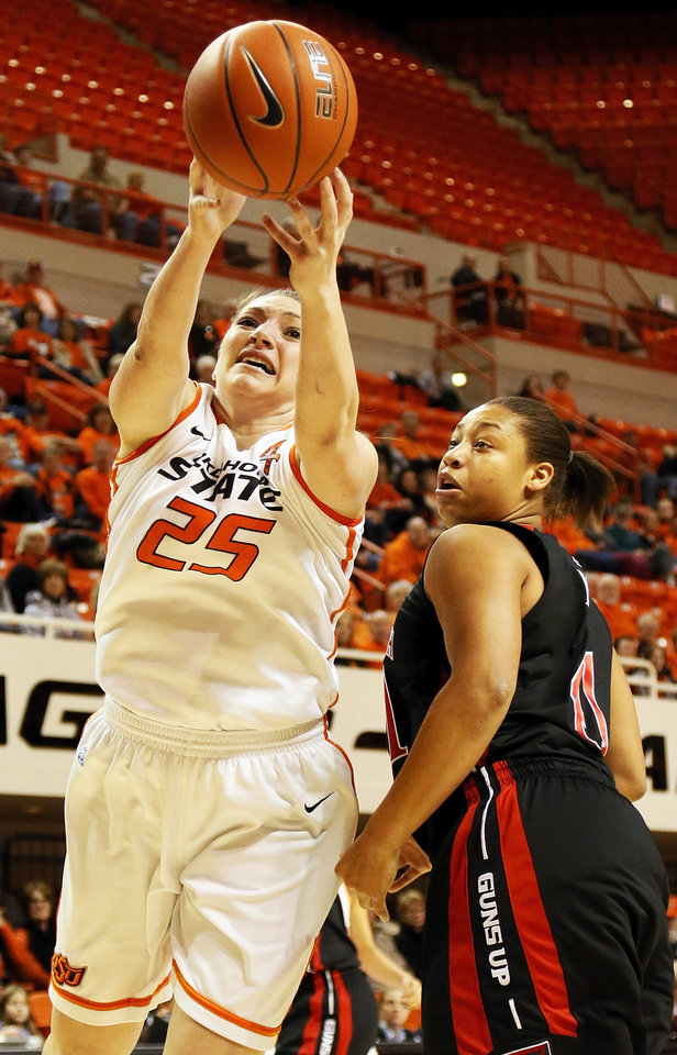 Oklahoma State's Lindsey Keller (25) tries to grab the ball next to Texas Tech's Kelsi Baker (41) during a women's college basketball game between Oklahoma State University (OSU) and Texas Tech at Gallagher-Iba Arena in Stillwater, Okla., Wednesday, Jan. 2, 2013. Photo by Nate Billings, The Oklahoman