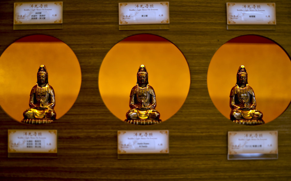 Photo -  Buddha statues are featured in the meditation room in the new Buddha Mind Monastery building in Oklahoma City. Photo by Chris Landsberger, The Oklahoman   CHRIS LANDSBERGER -