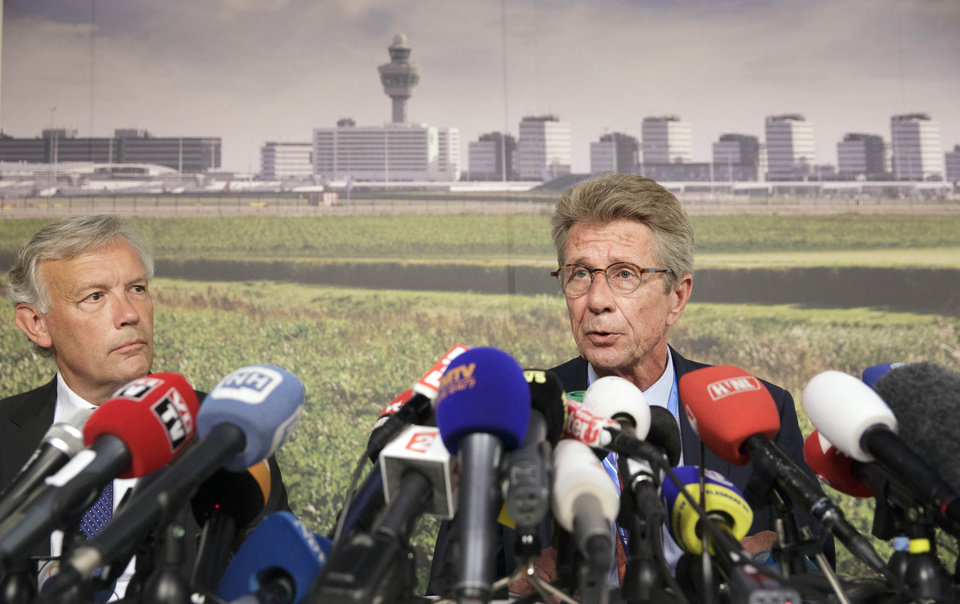Photo - Huib Gorter, senior vice-president of Malaysia Airlines, right, speaks at a press conference as Jos Nijhuis, president and CEO of Schiphol, left, listens, at Schiphol airport in Amsterdam, Thursday, July 17, 2014. An official with Malaysia Airlines says at least one Canadian was among the 295 people aboard a passenger plane that was downed today over Ukraine. Gorter says 154 people were Dutch, 27 were Australians, 23 were Malaysians, 11 were Indonesian, 6 were from the United Kingdom, 4 were from Germany, 4 were from Belgium, and 3 were from the Philippines. Gorter says authorities are still trying to determine the nationalities of the rest of the passengers. (AP Photo/Phil Nijhuis)