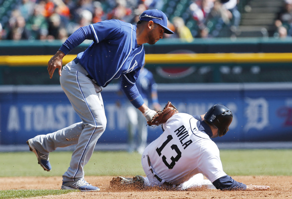 Photo - Kansas City Royals second baseman Omar Infante tags Detroit Tigers' Alex Avila (13) out attempting to steal second base in the third inning of a baseball game in Detroit Wednesday, April 2, 2014. (AP Photo/Paul Sancya)