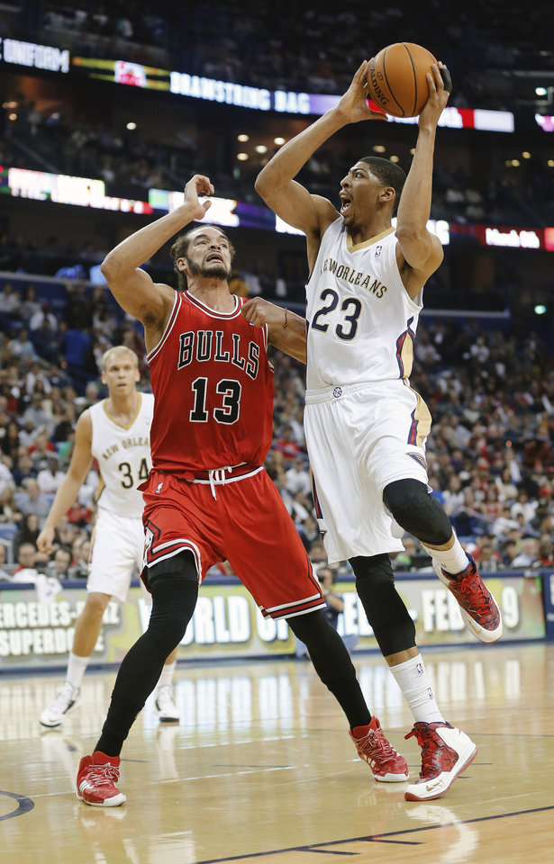 Photo - New Orleans Pelicans forward Anthony Davis (23) shoots over Chicago Bulls center Joakim Noah (13) during the first half of an NBA basketball game in New Orleans, Saturday, Feb. 1, 2014.  (AP Photo/Bill Haber)