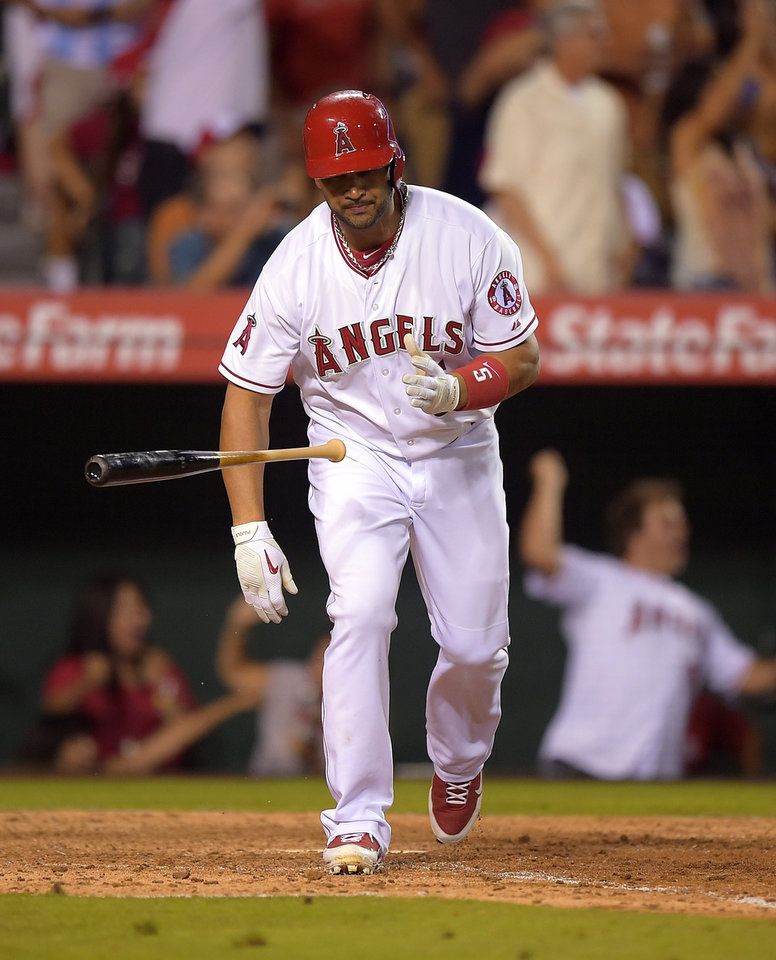 Photo - Los Angeles Angels' Albert Pujols tosses his bat as he hits a two-run home run during the seventh inning of a baseball game against the Houston Astros, Saturday, July 5, 2014, in, Anaheim, Calif.  (AP Photo/Mark J. Terrill)