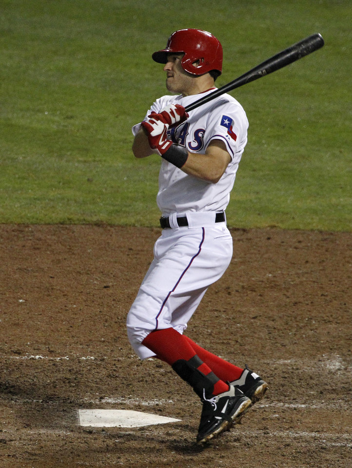 Photo -   Texas Rangers' Ian Kinsler follows through on a single to left off of Seattle Mariners' Hisashi Iwakuma in the fifth inning of a baseball game Friday, Sept. 14, 2012, in Arlington, Texas. (AP Photo/Tony Gutierrez)
