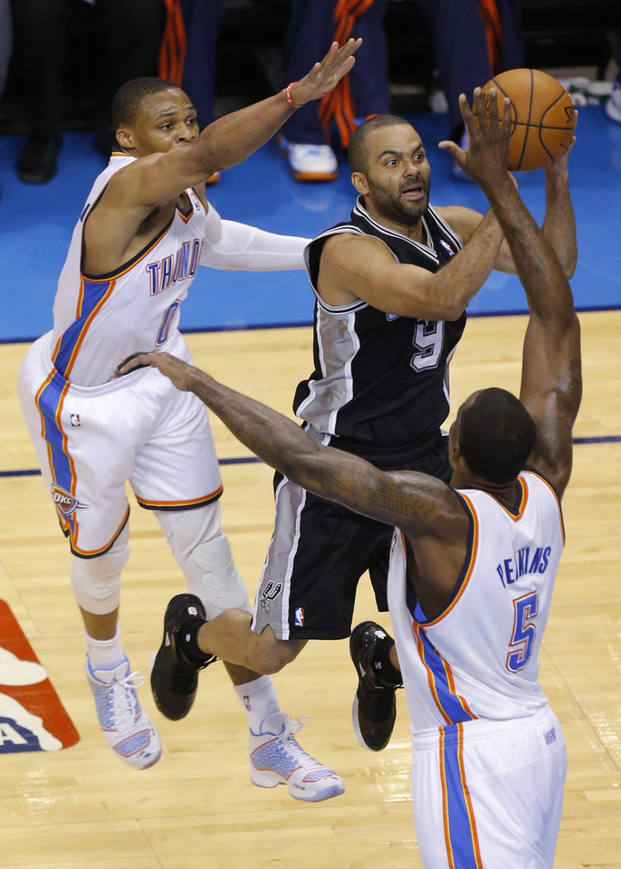 Photo - Oklahoma City's Russell Westbrook (0) and Kendrick Perkins (5) defend against San Antonio's Tony Parker (9) during Game 2 of the Western Conference semifinals in the NBA playoffs between the Oklahoma City Thunder and the Los Angeles Clippers at Chesapeake Energy Arena in Oklahoma City, Monday, May 7, 2014. Photo by Bryan Terry, The Oklahoman