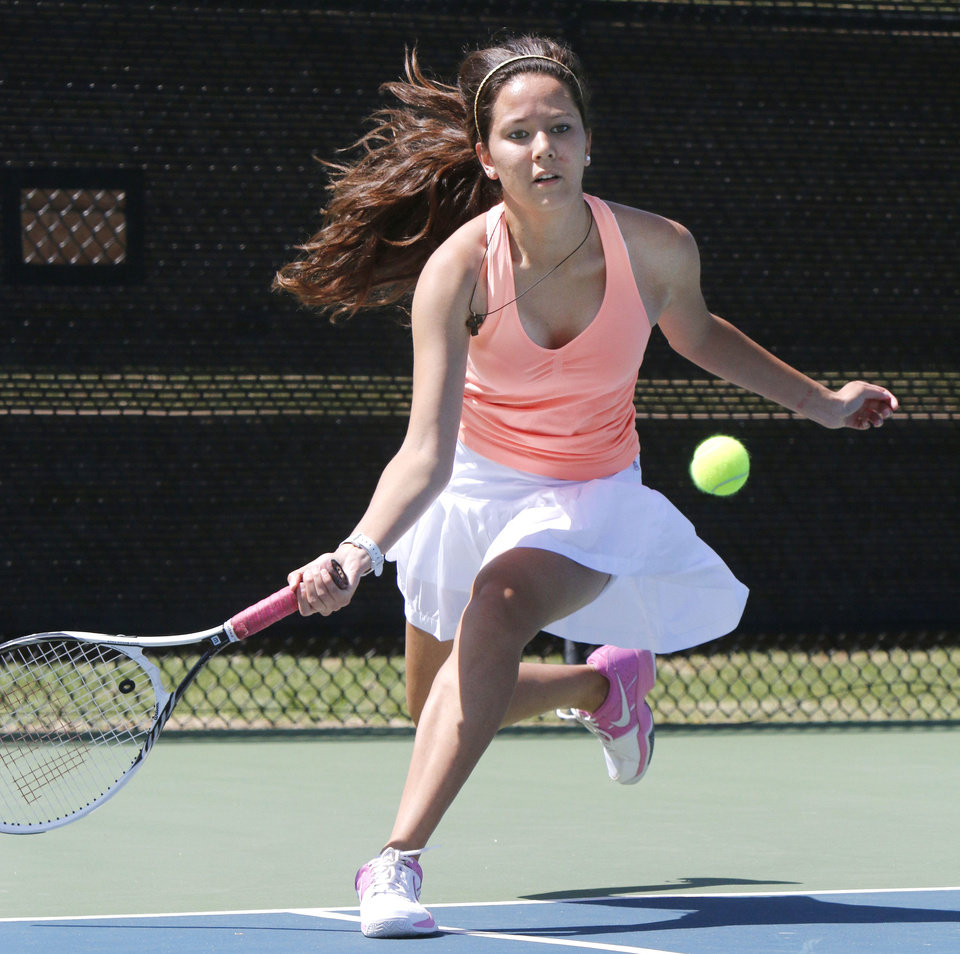 Photo - Western Heights' Tresa Nguyen plays against Carl Albert's Sara Lankford during the 5A Girl's state tennis tournament at the OKC Tennis Center in Oklahoma City, OK, Friday, May 9, 2014,  Photo by Paul Hellstern, The Oklahoman