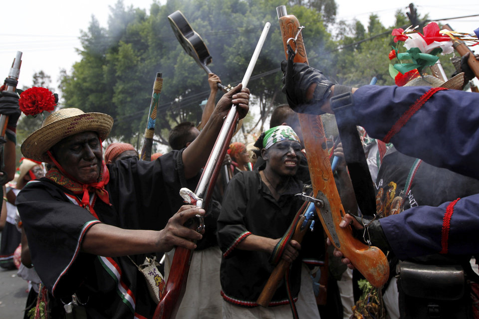 FILE - In this May 5, 2011 file photo, people take part in a recreation of the Battle of Puebla during