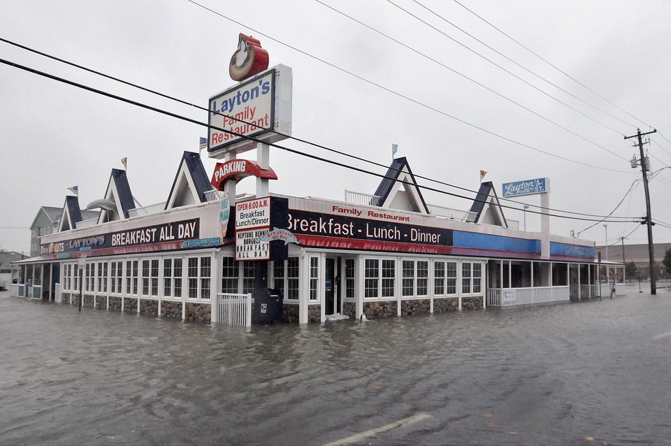 Photo -   Water floods the street near Layton's Monday, Oct. 29, 2012, in Ocean City, Md. Sandy is combining with a wintry storm from the west and cold air from the Arctic. The superstorm could menace some 50 million people in the nation's most heavily populated corridor, from big East Coast cities to the Great Lakes. (AP Photo/The Daily Times, Laura Emmons) NO SALES