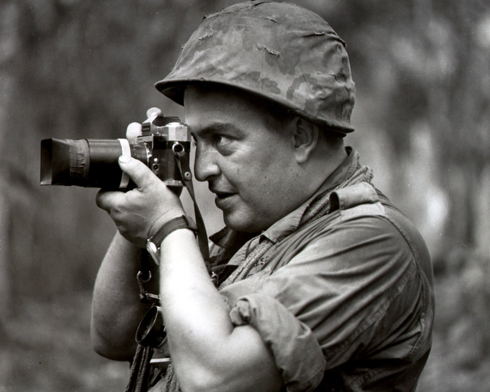 Photo -   FILE - In this 1967 file photo Associated Press photographer Horst Faas works in Vietnam. Faas, a prize-winning combat photographer who carved out new standards for covering war with a camera and became one of the world's legendary photojournalists in nearly half a century with The Associated Press, died Thursday May 10, 2012. He was 79. (AP Photo)