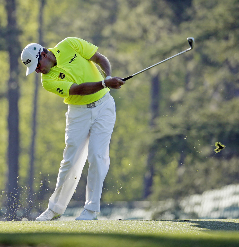Photo - Lee Westwood, of England, tees off on the 14th hole during the first round of the Masters golf tournament Thursday, April 10, 2014, in Augusta, Ga. (AP Photo/Charlie Riedel)