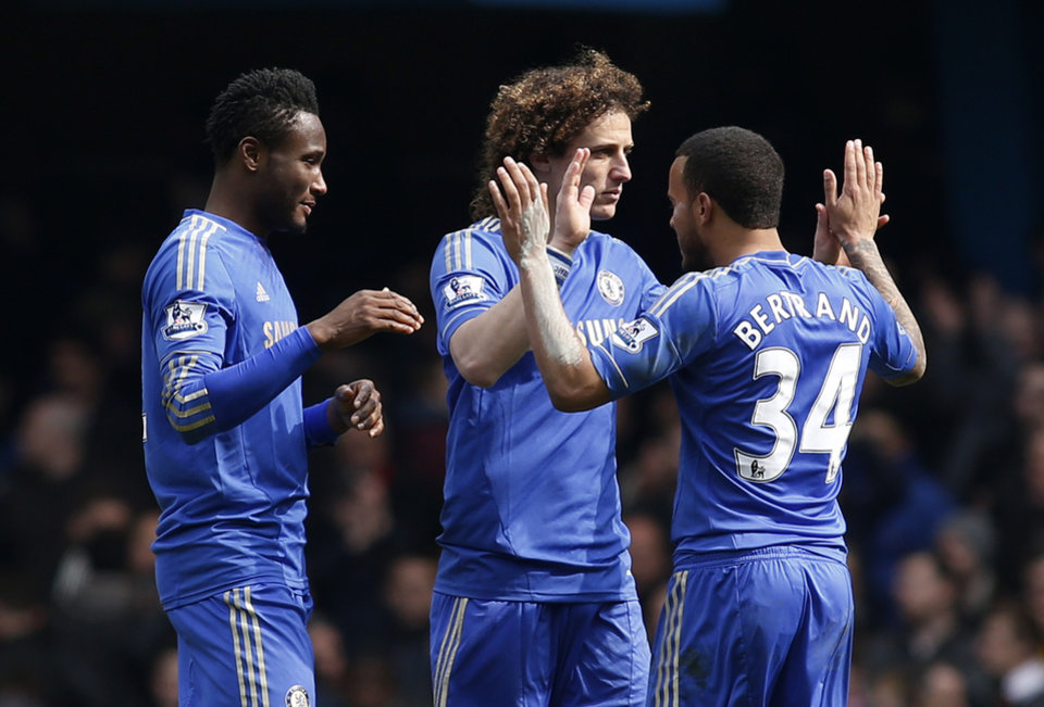 Chelsea's David Luiz, center, Ryan Bertrand, right, and John Obi Mikel react to their win against Manchester United at the end of their English FA Cup quarter final replay soccer match at Stamford Bridge, London, Monday, April 1, 2013. (AP Photo/Sang Tan)