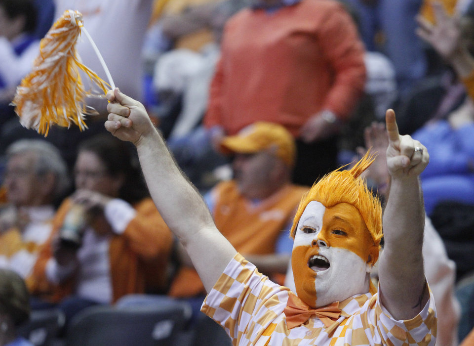 Photo - A Tennessee fan yells in the second half of an NCAA college basketball game between Tennessee and Vanderbilt, Monday, Feb. 10, 2014, in Knoxville, Tenn. Tennessee won 81-53. (AP Photo/Wade Payne)