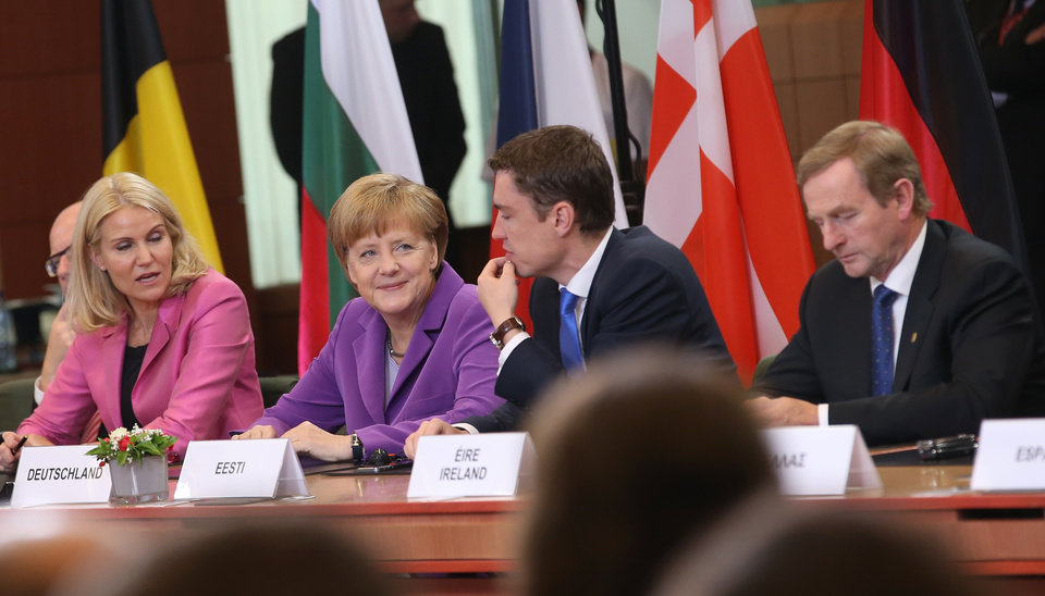 Photo - From left, Danish Prime Minister Helle Thorning-Schmidt, German Chancellor Angela Merkel, Estonian Prime Minister Taavi Roivas and Irish Prime Minister Enda Kenny participate in a signing ceremony at an EU summit in Brussels on Friday, June 27, 2014. The Ukrainian President Petro Poroshenko has signed up to a trade and economic pact with the European Union, saying it may be the