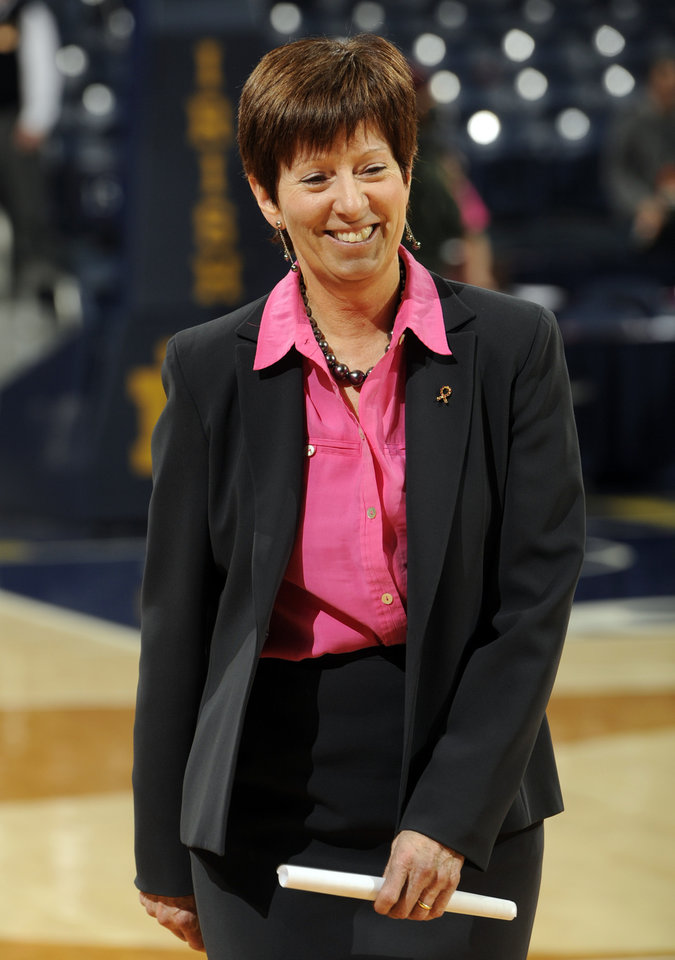 Photo - Notre Dame coach Muffet McGraw smiles after an NCAA college basketball game against Syracuse, Sunday Feb. 9, 2014, in South Bend, Ind. Notre Dame won 101-64. (AP Photo/Joe Raymond)