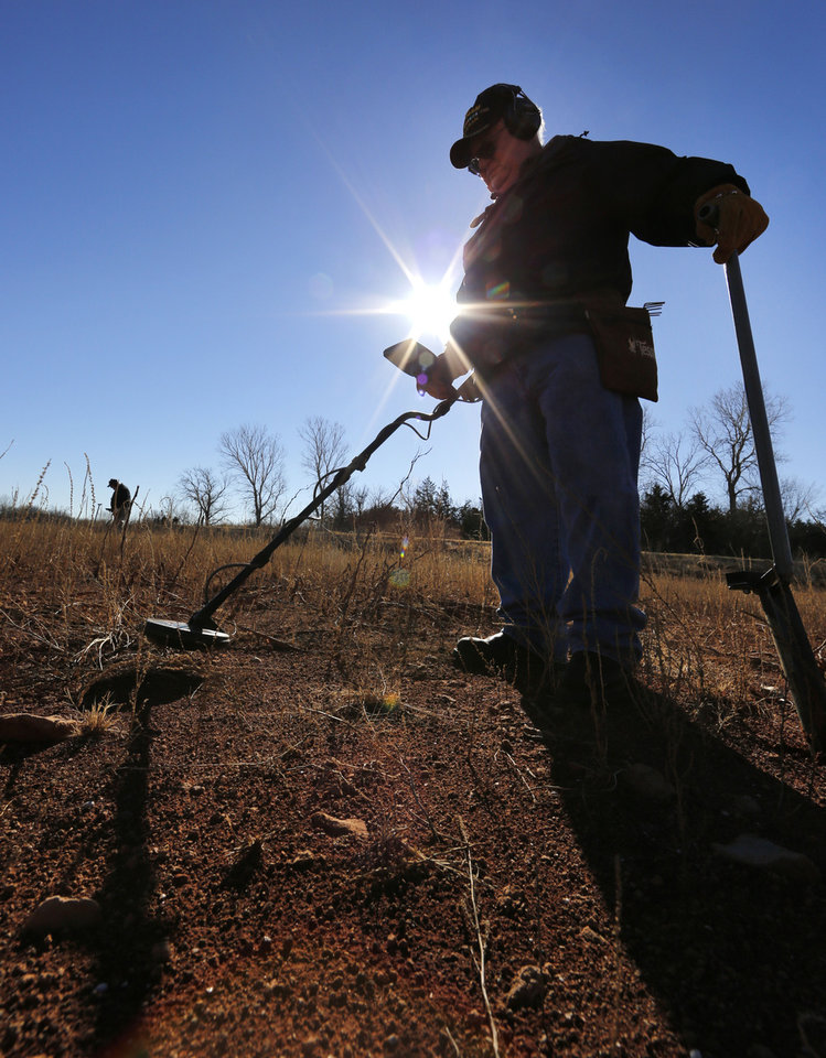LOST METAL: Larry Dobbs uses a metal detector as he looks for lost items at Lake Hefner in Oklahoma City, Thursday January  17, 2013. Area lakes are very low due to the recent drought. Photo By Steve Gooch, The Oklahoman