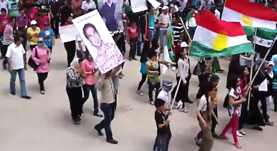 Photo -   This image made from amateur video released by the Shaam News Network and accessed Friday, May 4, 2012, purports to show Syrians chanting slogans and carrying Kurdish flags during a demonstration in Qamishli, the capital of Syria's Kurdish heartland. (AP Photo/Shaam News Network via AP video) TV OUT, THE ASSOCIATED PRESS CANNOT INDEPENDENTLY VERIFY THE CONTENT, DATE, LOCATION OR AUTHENTICITY OF THIS MATERIAL