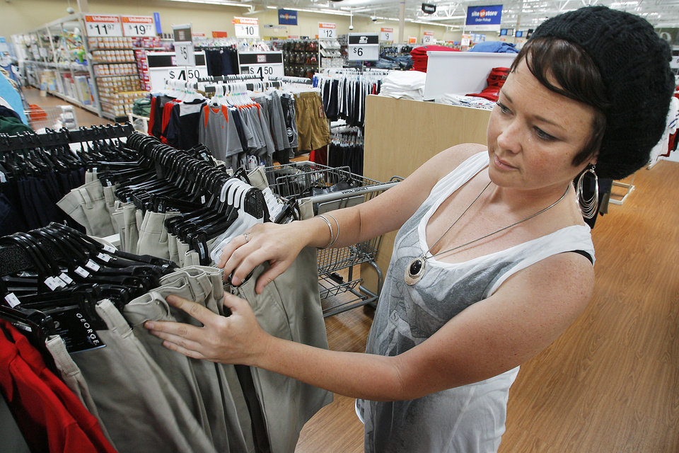Jennifer Hoppis, from Oklahoma City, shops for her sons school clothes  at the beginning of the Tax Free Weekend, Friday, August 7, 2009 at the Belle Isle Walmart.    Photo By David McDaniel, The Oklahoman.