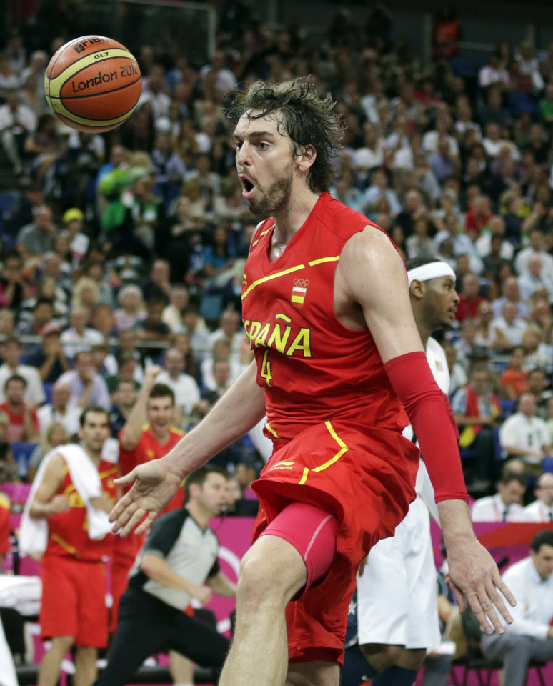 Spain's Pau Gasol reacts after a dunk during the men's gold medal basketball game against USA at the 2012 Summer Olympics, Sunday, Aug. 12, 2012, in London. (AP Photo/Charles Krupa)